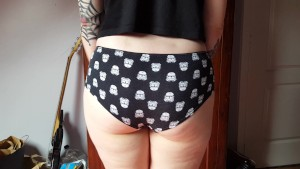Inked girl shows her round assets in Star Wars panties