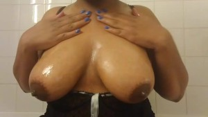 Ebony BBW playing with big tits and dildo