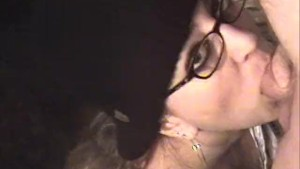 Sexy brunette with glasses blows cock and eats cum