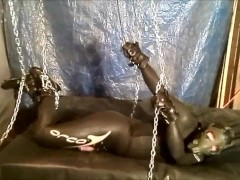 Chained masked wetsuited Orca struggles to jerk off
