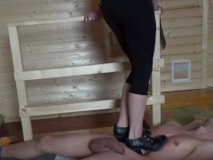 Black heels boots cruel trampling and stinging the heels into the body