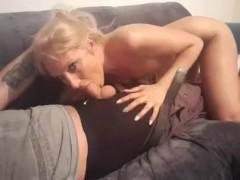 Sexy slut gives sloppy blow job on sofa