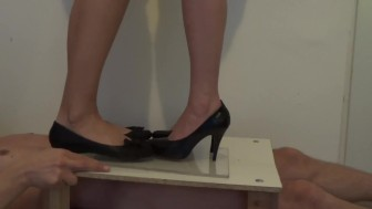 Very brutal cock crushing under plexi glass. Hard high heels stomping
