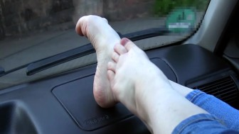 Feet on dashboard driving