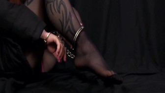 Cuffed posing in nylons wearing anorak