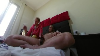 Blonde gives nice happy handjob while smoking
