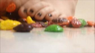 Crushing skittles barefoot