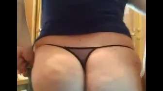 BBW Ass in G-string jiggles into tight jeans.
