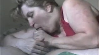 Housewife sucks husbands oil soaked cock till he cums hard..