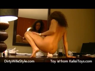 Hot brunette wife rides dildo in hotel in front of mirror