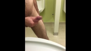 Playing with my well hung white cock in public bathroom