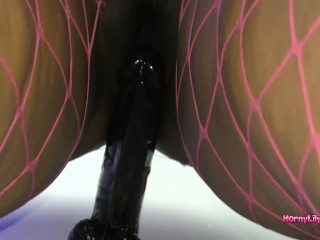 HornyLily Riding bbc sex toy on the wall in fishnet stockings