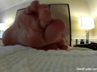 Dani Daniels teases the camera with her cute feet