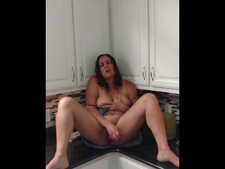 Busty Horny milf performs with toy then smashes herself on kitchen counter