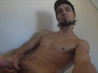 Stroking to porn ending with cumshot