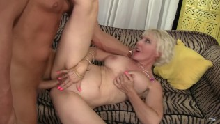 Sexy in shape blonde MILF having sex on the couch