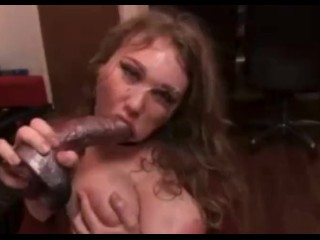 Whore throat fucks huge dildo while slapping face and chocking herself
