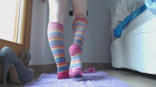 young girl pisses on colored socks