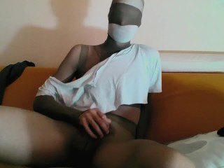 YOUNG GUY IN TAN PANTYHOSE ENCASEMENT AND SNEAKERS JERKING OFF