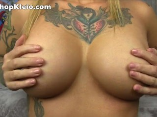 Kleio Valentien Oils up her big tits and plays with them for you to worship
