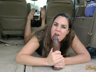 Hot curvy MILF fucks big toy in public