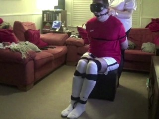 Male Strictly bound gagged and hogtied in football kit