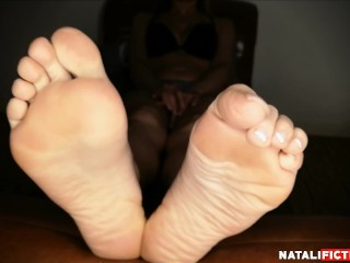 Playing with my feet and showing my soles