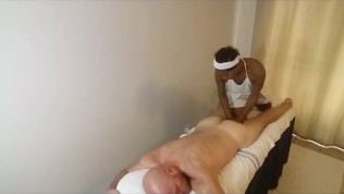 African Massage Therapist gives American Hunk rub down and happy ending