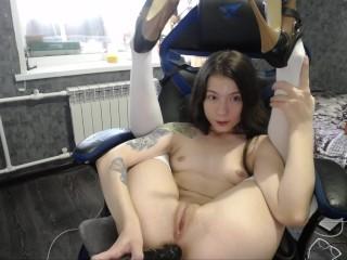 Cute girl fucks herself with a big black dildo in a bear costume