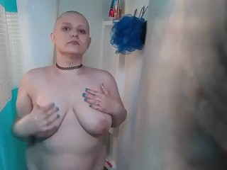 Bald girl in the shower after headshave