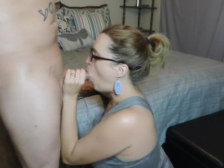 Hot MILF in glasses gets a massive facial