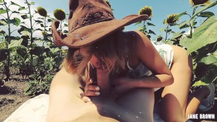 POV Outdoor. Cowgirl riding in a field of sunflowers