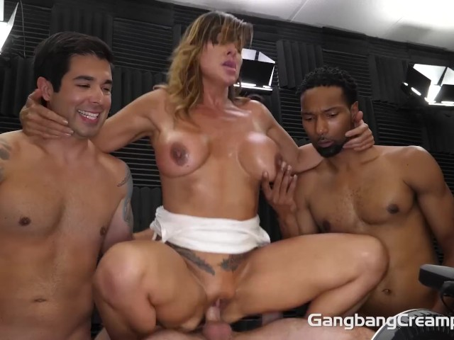 Busty Milf Plays With the Cocksmen