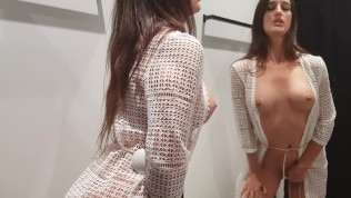Girl changes clothes in a fitting room