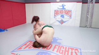 Busty Bella Rossi wrestling fight gives the strapon to Stephie Staar