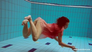 Hot wet babe Deniska swims nude