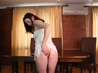 Beautiful girl plays with a dildo on the kitchen table