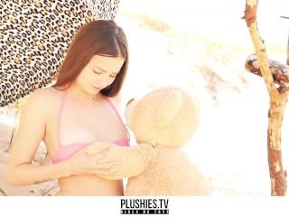 diana haddie beautiful hot model playing with teddy bear on the beach