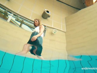 Teen Avenna swims naked wet in the pool