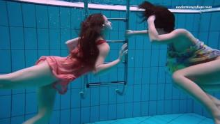 Naked Russian girls swim underwater