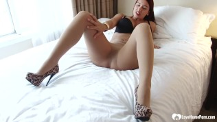 redhead in high heels shows off her perfect body