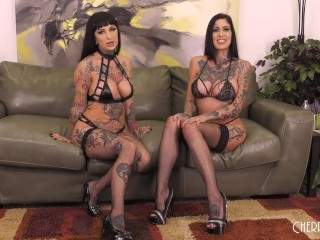 Inked Babes Riding Sybian and Scissoring in Live Show