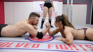 Woman vs Man in arm wrestling as Brandi Mae goes up against Jack Friday