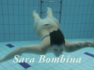 Baby swims and strips showing her sexy twat
