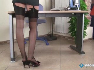 sexy redhead secretary puts her nylon feet in your face