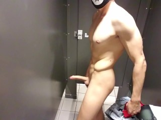 Exhibitionist Jacks Off at Busy Airport Bathroom with Door Open and Cums