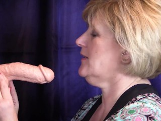 Mature Milf Gobbles thick dildo that fills her mouth with creamy goo!