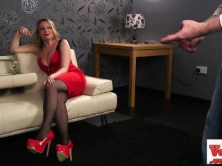 Busty british voyeur instructing sub from sofa