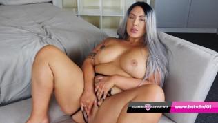 Buxom UK BBW Danielle rubs her pussy on the sofa