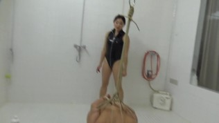 Beautiful Mistress Amrita Tortures Her Latex Bondage Slave With Water